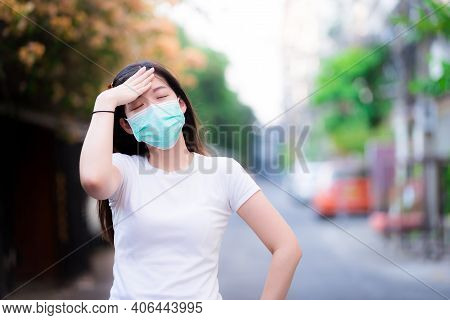 Woman Wearing Green Mask Shows Dizzy From Toxic Air Pollution Pm2.5. People Are Not Comfortable. Per