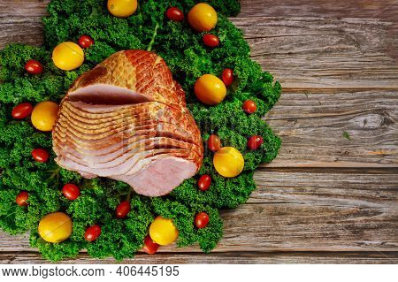 Cooked Spiral Sliced Hickory Smoked Ham With Fresh Lemon, Kale And Tomatoes. Holiday Meal.