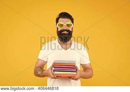 Book Store Concept. Students Life. Prepare For Exams. Funny Man In Party Glasses Hold Notebooks. Fun