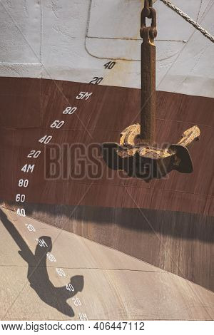 Perspective Side View Of The Old Rusty Anchor With Draft Mark Numbers On Fore Side Of Large Vessel H