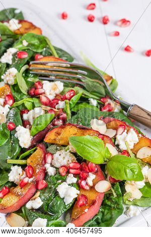 Salad. Spring Vegetable Salad. Fresh Vegetable Salad With Grilled Peach, Pomegranate, Spinach And Fr