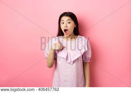 Surprised Asian Girl Gasping Wondered, Pointing At Herself, Being Chosen Or Picked, Standing In Dres