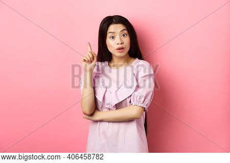 Excited Asian Woman Pitching An Idea, Raising Finger In Eureka Sign, Have Plan Or Solution, Standing