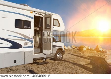 Photo of caravan by a Lake with lens flare