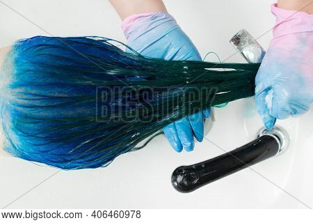 Top View Of Hairdresser In Gloves Washes Clients Head With Long Hair Sapphire Color After Hair Color