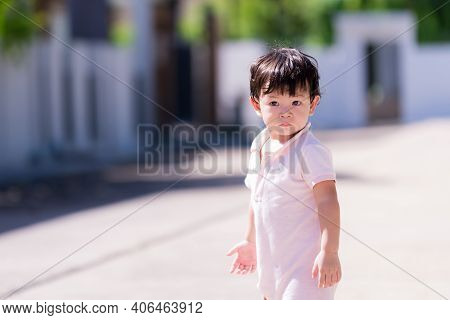 Candid Cute Little Boy Sweating On Face. Happy Healthy Sweaty Face Child. Baby Aged 1-2 Years Old. T