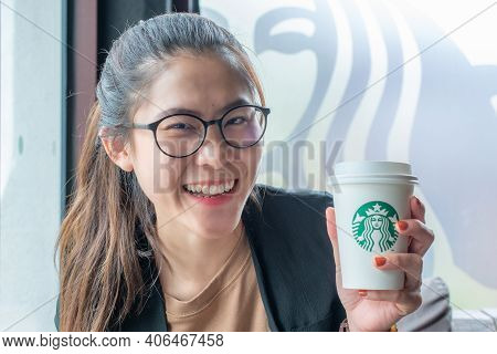 Chiang Mai, Thailand : May-15-2019 : Happiness Asian Woman Holding A Cup Of Starbucks Coffee In Star