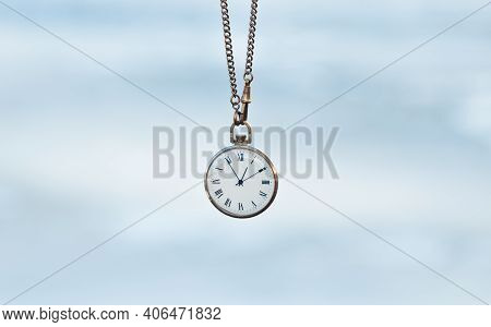 Old Pocket Watch On A Chain. The Concept Of The Passing Time