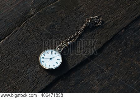 Pocket Watch On A Wooden Background. View From Above. Copy Space.