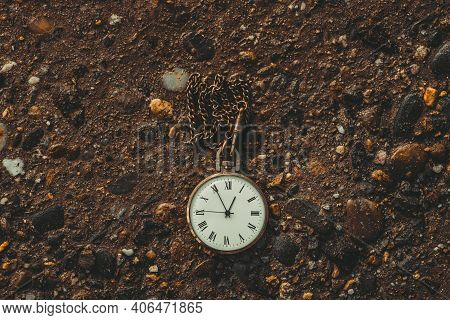 Old Pocket Watch On The Ground. The Concept Of The Passing Time