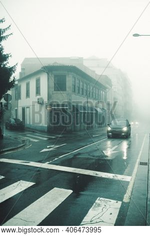 View of the deserted foggy street in Porto, Portugal.