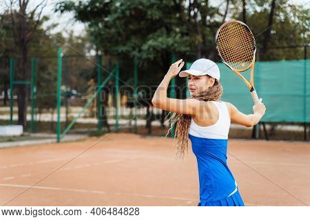 Professional Equipped Female Tennis Player Beating Hard The Tennis Ball With Racquet. Its Good Havin