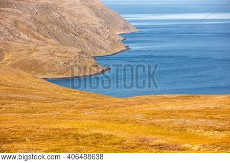 Barents Sea. Beautiful Rocky Seashore Shoreline In Northern Norway. Wild Nature Of Norway. Nordkapp,