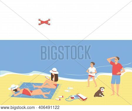 Family Resting On The Beach By The Sea In Seclusion. Dad And Son Are Launching A Quadcopter. Mom And