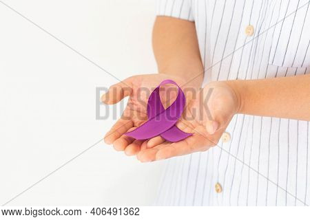 Hands Holding Purple Or Violet Ribbon On White Background, Copy Space. Pancreatic Cancer ,testicular