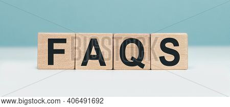 Faqs - Word Concept From Wooden Blocks. Wooden Cubes With Letters