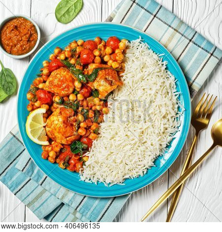 Chicken And Chickpea Curry With Rice With Cherry Tomatoes, Spinach, Ginger, Yellow Curry Paste Serve