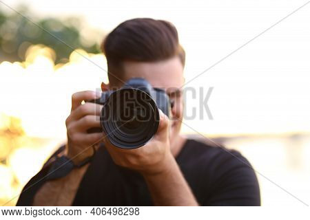 Photographer Taking Picture With Professional Camera In Countryside, Focus On Lens