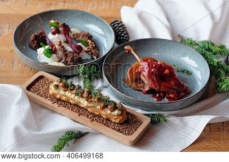 For Dinner, The Table Is Served With Luxurious Poultry Dishes With Sweet Berry Sauce, An Unusual Des