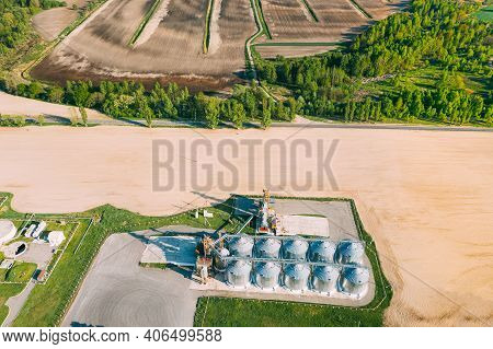 Aerial View Modern Granary, Grain-drying Complex, Commercial Grain Or Seed Silos In Sunny Spring Rur