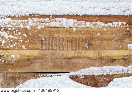 old rough wooden plank background, weathered and covered snow in winter, blizzard and snowfall