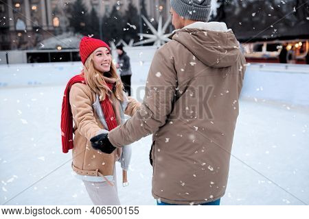 Happy Couple Skating At Outdoor Ice Rink