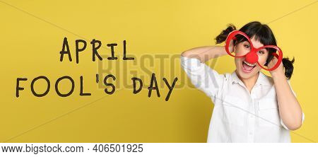 Funny Woman With Large Glasses And Clown Nose On Yellow Background, Banner Design. April Fool's Day