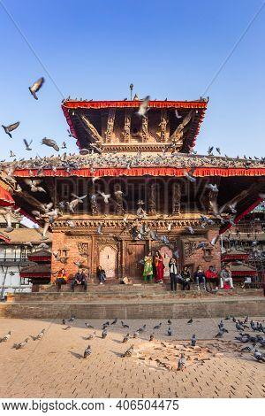 Kathmandu, Nepal - November 13, 2019: Many Doves Flying Up At The Durbar Square In Kathmandu, Nepal
