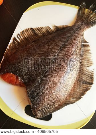 Fresh Halibut On The Table Ready To Cook
