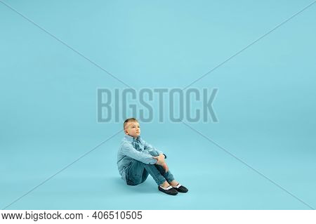 Dreaming. Childhood And Dream About Big And Famous Future. Pretty Little Boy Isolated On Blue Studio