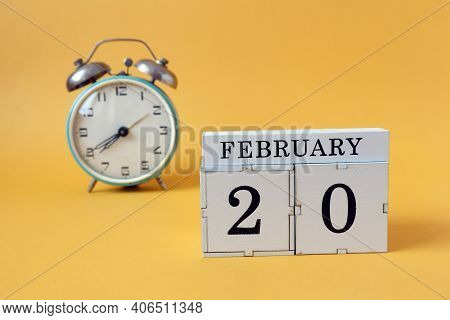 Calendar For February 20: Cubes With The Number 20 And The Name Of The Month, Alarm Clock On A Yello