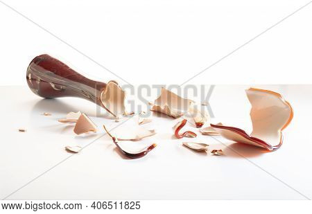 Broken Glass To Pieces. Lots Of Small Glass From A Vase. Superstition. Vase On A White Background.