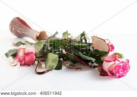 A Bouquet Of Roses In A Broken Vase. Spoiled Flowers In A Vase. Broken Bouquet Of Roses In A Vase.