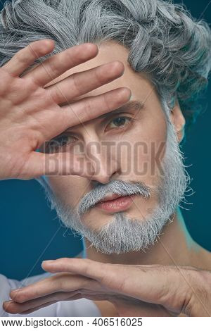 Divine man with a beard and curly hair on a blue background. Art image of God. Roman and Greek mythology, Christianity and religion.