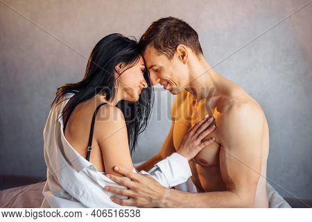 Close-up Of A Beautiful, Nude Couple Of Two Young People In Love Having Sex In Bed In A Hotel Room O