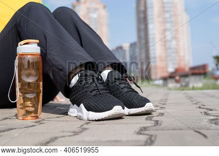 Close Up Of Sports Woman Sitting On The Sports Ground