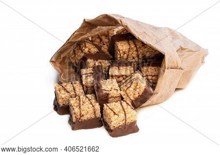 Mini  Rice And Syrup Flapjack Slices In Paper Bag Isolated On White