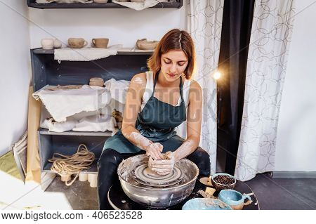 With Professional Hand Movements, A Female Potter Prepares A Piece Of Clay On A Potter's Wheel, Knea