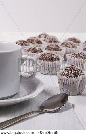 A Lot Of Oats Bonbons And A Cup In A White Background