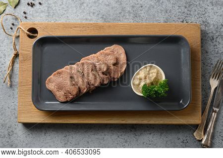 Sliced Beef Tongue Delicacy Serving With Horseradish Sauce On Wooden Board And Grey. View From Above