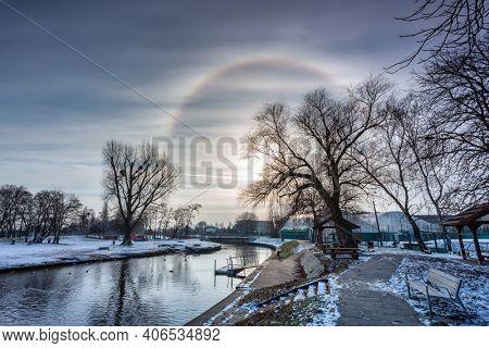 Halo effect around the sun in the winter park, Pruszcz Gdanski. Poland