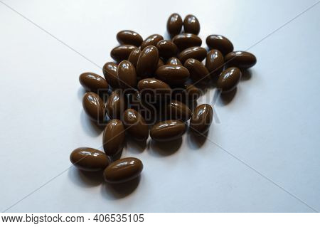 Brown Softgel Capsules Of Vitamin D3 In A Heap