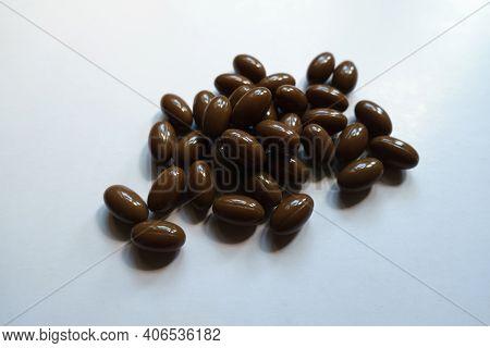 Heap Of Brown Softgel Capsules Of Vitamin D3