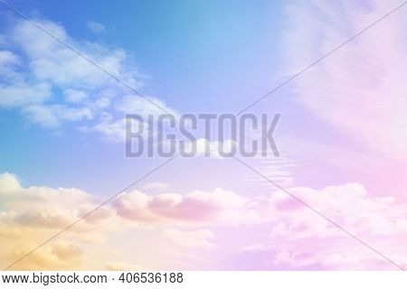 Colourful Sky With Soft Clouds With Pastel Colour In Blue, Puple, Pink, Yellow And Orange Colour. Be