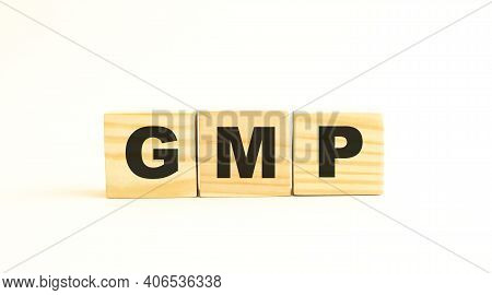 The Word Gmp. Wooden Cubes With Letters Isolated On White Background. Conceptual Image.