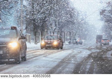 Car Driving On Snowy Urban Street.winter City