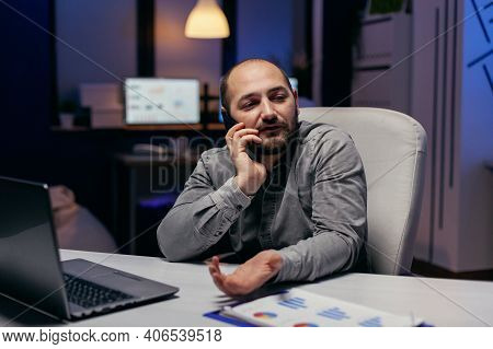 Frustrated Business Man Working Late In Office Talking On Phone Doing Assignment. Manager Having A B
