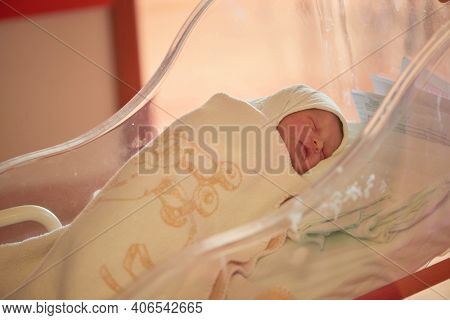 newborn baby sleeping in bed at hospital