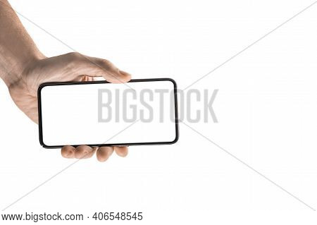Mockup Image, Man Hand Holding Black Smartphone Isolated On White Background. Person Holding Cell Ph