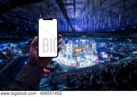 Gamer Using Smartphone During Big Esports Gaming Event Sitting On The Tribunes Inside The Arena. Bla